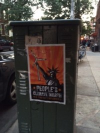 People's Climate March flyer on utility box in Brooklyn